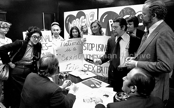 """The National Organization for Women (NOW) protests the """"Fly Me"""" ad campaign released in 1971 by National Airlines. NOW denounced the campaign for the depiction of women as sex objects. New York City. L86629-C01-F25A. Photo by John G. Zimmerman."""