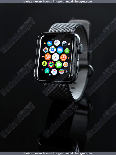 Shiny steel Apple Watch series 2 smartwatch with app icons on display isolated on black background