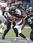 Seattle Seahawks linebacker Bobby Wagner (54) wraps up Denver Broncos wide receiver Jordan Norwood (11) during the second quarter at CenturyLink Field on August 14, 2015 in Seattle Washington.  The Broncos beat the Seahawks 22-20.  © 2015. Jim Bryant Photo. All Rights Reserved.