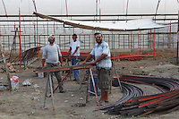 Ironworkers at work at the ancient Greek archaeological site of Letoon, near Xanthos, Antalya, Turkey. The Letoon or Sanctuary of Leto was the sacred cult centre of Lycia, its most important sanctuary, and was dedicated to the 3 national deities of Lycia, Leto and her twin children Apollo and Artemis. Leto was also worshipped as a family deity and as the guardian of the tomb. The site is 10km South of the ancient city of Xanthos in Lycia, near the modern-day village of Kumluova, Fethiye. Founded in the 6th century BC, the Greek site also flourished throughout Roman times, and a church was built here in the Christian era. The site was abandoned in the 7th century AD. Picture by Manuel Cohen