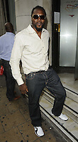 Audley Harrison.The Prince Albert II of Monaco Olympians Reception, Old Burberry Building, Haymarket, London, England..August 9th, 2012.full length sunglasses shades white shirt jeans denim stripe beard facial hair .CAP/CAN.©Can Nguyen/Capital Pictures.