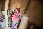 In the village of Kalabougou near Segou, Mali, women of the numu blacksmiths population have worked for centuries as traditional potters.  A 7-day fabrication cycle leads to the weekly Saturday afternoon firing of the kilns, in which large stacks of pots are covered with grass and set on fire.