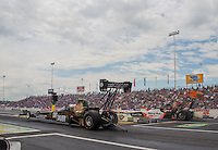 Jun 6, 2015; Englishtown, NJ, USA; NHRA top fuel driver Morgan Lucas (near lane) races alongside Clay Millican during qualifying for the Summernationals at Old Bridge Township Raceway Park. Mandatory Credit: Mark J. Rebilas-