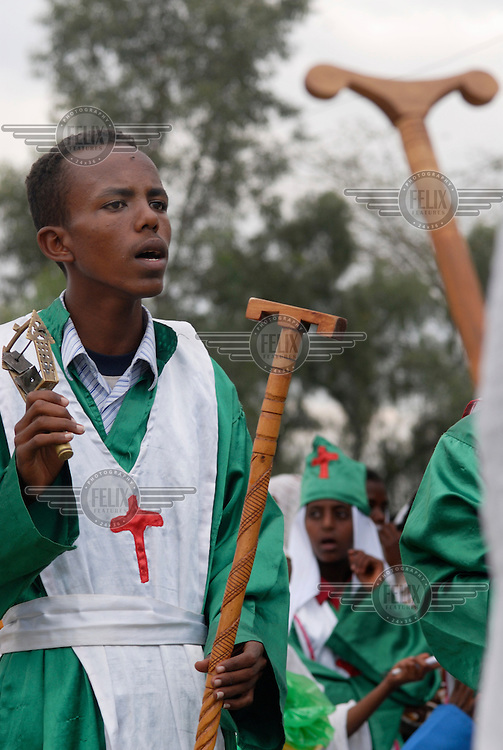 An Orthodox worshipper in traditional dress plays a sistrum during ceremonial Meskel celebrations. Meskel (meaning 'cross' in Ge'ez) is an annual religious holiday in the Ethiopian Orthodox Church commemorating the Finding of the True Cross by Queen Eleni (Saint Helena) in the fourth century.