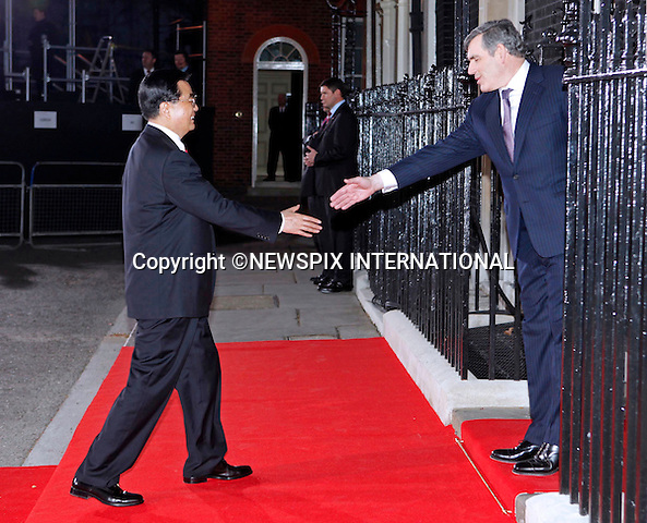 "HU JINTAO AND GORDON BROWN.Prime Minister Gordon Brown hosted a dinner for the G20 Summit World Leaders on the eve of the summit, London_01/04/2009.Photo Distributed by : Newspix International..**ALL FEES PAYABLE TO: ""NEWSPIX INTERNATIONAL""**..PHOTO CREDIT MANDATORY!!: NEWSPIX INTERNATIONAL(Failure to credit will incur a surcharge of 100% of reproduction fees)..IMMEDIATE CONFIRMATION OF USAGE REQUIRED:.Newspix International, 31 Chinnery Hill, Bishop's Stortford, ENGLAND CM23 3PS.Tel:+441279 324672  ; Fax: +441279656877.Mobile:  0777568 1153.e-mail: info@newspixinternational.co.uk"