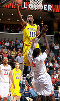CHARLOTTESVILLE, VA- NOVEMBER 29: Tim Hardaway Jr. #10 of the Michigan Wolverines shoots over Assane Sene #5 of the Virginia Cavaliers during the game on November 29, 2011 at the John Paul Jones Arena in Charlottesville, Virginia. Virginia defeated Michigan 70-58. (Photo by Andrew Shurtleff/Getty Images) *** Local Caption *** Assane Sene;Tim Hardaway Jr.