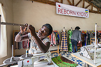 Africa, Rwanda, Kigali. Women for Women project. Women sewing clothing on industrial machines for export through the Reborn Kyoto  company. Denyse Uwase