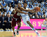 30 January 2016: North Carolina's Nate Britt (0) and Boston College's Sammy Barnes-Thompkins (55). The University of North Carolina Tar Heels hosted the Boston College Eagles at the Dean E. Smith Center in Chapel Hill, North Carolina in a 2015-16 NCAA Division I Men's Basketball game. UNC won the game 89-62.