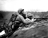 Observer who spotted a machine gun nest finds its location on a map so they can send the information to artillery or mortars to wipe out the position.  Iwo Jima, February 1945.  Dreyfuss.  (Marine Corps)<br /> Exact Date Shot Unknown<br /> NARA FILE #:  127-N-109619<br /> WAR &amp; CONFLICT BOOK #:  1218