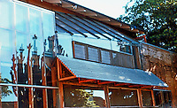 """Frank Gehry: Gehry House, west side overlooking enclosed yard with exposed 2""""X 4"""" studs of original building.  Photo '86."""