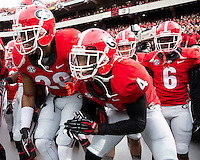 The Georgia Bulldogs beat the App State Mountaineers 45-6 in their homecoming game.  After a close first half, UGA scored 31 unanswered points in the second half.  Georgia players take the field