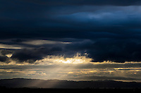 The dark clouds parted and a shaft of light shown down along San Francisco Bay.