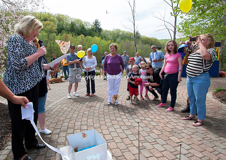 BEACON FALLS, CT - 09 APRIL 2015 - 050915JW10.jpg -- Butterflies are released in memoriam while Beacon Falls State Rep. Theresa Conroy reads aloud the names of those remebered Saturday afternoon during the Beacon Falls 17th Annual Duck Race Day. Jonathan Wilcox Republican-American