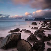 Rugged rocky coastline at Myrland beach, Flakstadoy, Lofoten Islands, Norway