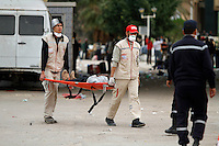 Medics carry a man on a stretcher at the Tunisian side of the border. Tens of thousands of people, mainly Egyptian workers, flee unrest in Libya and cross the border into Tunisia. Some slept in the open for several days before being processed.  At the same time forces loyal to Col. Gaddafi fought opposition forces in various parts of the country.
