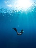 Mermaid swimming in the deep blue ocean<br /> Virgin Islands