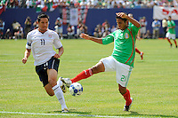 Juan Carlos Valenzuela (21) of Mexico (MEX) plays the ball as Brian Ching (11) of the United States (USA) closes. Mexico (MEX) defeated the United States (USA) 5-0 during the finals of the CONCACAF Gold Cup at Giants Stadium in East Rutherford, NJ, on July 26, 2009.