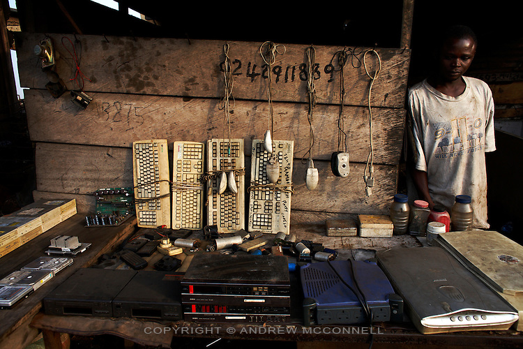 A man stands by this stall containing all sorts of salvaged electronics such as keboards, mice, scanners, hard drives,  at Agbogbloshie dump, in Accra, Ghana.