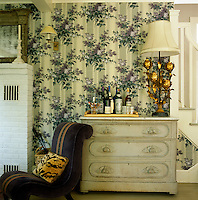 A painted antique French dresser also doubles as a bar in the corner of the living room