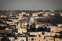 In this Monday, Oct. 07, 2013 photo, smoke rises from the battlefield as opposition fighters carry out an attack over Wadi Al-Deef military post at the frontline in Maraat Anouman in the Idlib province countryside of Syria. (AP/Photo)