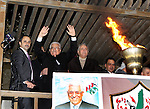 Palestinian President Mahmud Abbas lights a flame as thousands of Palestinians look on, on the eve of the 48th anniversary of the formation on the Fatah movement, on December 31, 2012, in the West Bank city of Ramallah. The Fatah anniversary commemorates the first operation against Israel claimed by its armed  wing then known as Al-Assifa (The Thunderstorm in Arabic) on January 1, 1965. Photo by Thaer Ganaim