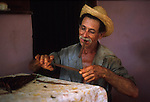 A farmer rolls a cigar with tobacco from his own fields in the Vinales region of Cuba - home of the tobacco for Cuba's famous cigars.