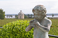 Statue Pan. On the terrasse. View towards Ch Latour. Chateau Pichon Longueville Comtesse de Lalande, pauillac, Medoc, Bordeaux, France
