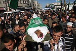 Palestinians carry the body of Hussam al-Hams, a member of Hamas' security forces, during his funeral in Rafah, in the southern Gaza Strip November 30, 2012. Al-Hams died on Thursday of a wound he suffered from an Israeli air strike during an eight-day cross-border violence, Palestinian medics said. Eight days of Israeli air strikes on Gaza and cross-border Palestinian rocket attacks ended in an Egyptian-brokered truce agreement that called on Israel to ease restrictions on the territory. Photo by Eyad Al Baba