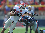 Georgia tight end Aron White (81) is tackled by Ole Miss' Ralph Williams (44) at Vaught-Hemingway Stadium in Oxford, Miss. on Saturday, September 24, 2011. Georgia won 27-13.
