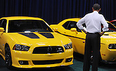United States President Barack Obama looks at Dodge Charger during a visit to the DC Auto Show at the Walter E. Washington Convention Center in Washington, DC on January 31, 2012. .Credit: Olivier Douliery / Pool via CNP