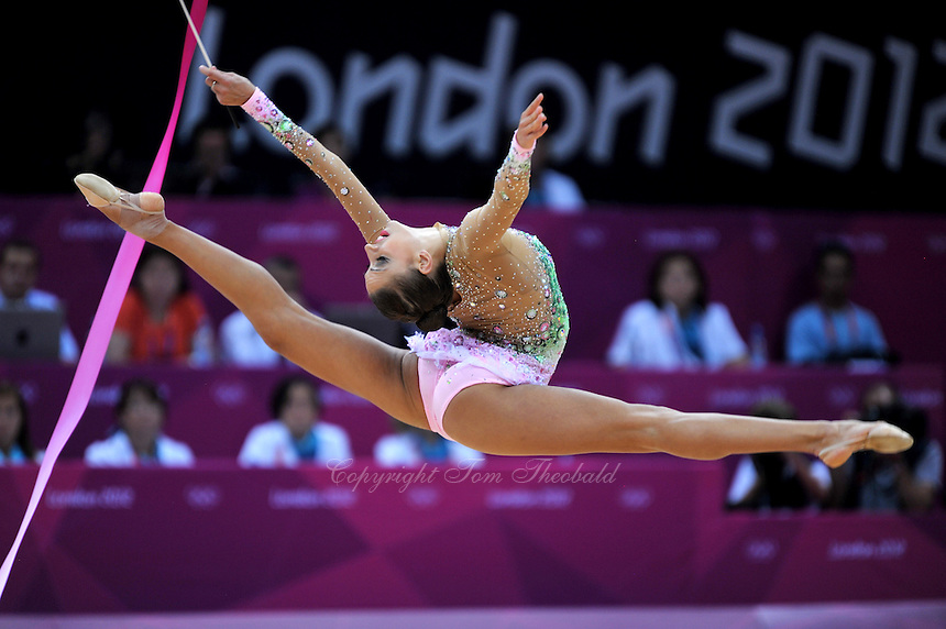 August 10, 2012; London, Great Britain;  EVGENIYA KANAEVA of Russia performs with ribbon during day 2 of rhythmic gymnastics qualifying at London 2012 Olympics.