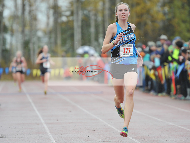 Chugiak's Emma Nelson leads the field into the finish line at Saturday's Region IV Championships.  Photo for the Star by Michael Dinneen