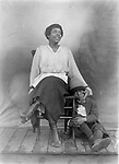 MOTHER AND SON. This woman and boy are unidentified, but surely the photograph captures a mother's reassuring touch.<br /> <br /> Photographs taken on black and white glass negatives by African American photographer(s) John Johnson and Earl McWilliams from 1910 to 1925 in Lincoln, Nebraska. Douglas Keister has 280 5x7 glass negatives taken by these photographers. Larger scans available on request.