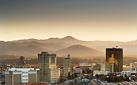 View of downtown Asheville, North Carolina from a residential neighborhood,  showcasing the close proximity of the mountains to this charming southern city.