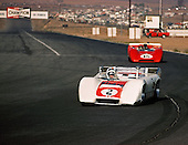Brett Lunger in Caldwell D7 leads Lola of Brian O'Neil into Riverside Turn 9 during 1968 Can-Am