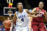 17 November 2013: Duke's Chloe Wells (4) and Alabama's Emily Davis (34). The Duke University Blue Devils played the University of Alabama Crimson Tide at Cameron Indoor Stadium in Durham, North Carolina in a 2013-14 NCAA Division I Women's Basketball game. Duke won the game 92-57.