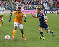 Houston Dynamo midfielder Warren Creavalle (5) traps the ball as New England Revolution midfielder Diego Fagundez (14) moves in to tackle.  The New England Revolution played to a 1-1 draw against the Houston Dynamo during a Major League Soccer (MLS) match at Gillette Stadium in Foxborough, MA on September 28, 2013.