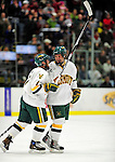 6 December 2009: University of Vermont Catamount forward Justin Milo (left), a Junior from Edina, MN, congratulates Colin Vock (right), a Senior from Detroit, MI, on scoring in the second period during a game against the University of New Hampshire Wildcats at Gutterson Fieldhouse in Burlington, Vermont. The Wildcats defeated the Catamounts 5-2 in the Hockey East matchup. Mandatory Credit: Ed Wolfstein Photo