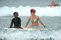 "Saturday, August 23 2008.  Volunteer Maddie Rupp gives ""Chare"" (no last name given) a surf lesson during the 22nd Annual Kids Day hosted by the Windansea Surf Club at La Jolla Shores."