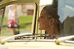 The bride arrives in her father's vintage VW Beetle.