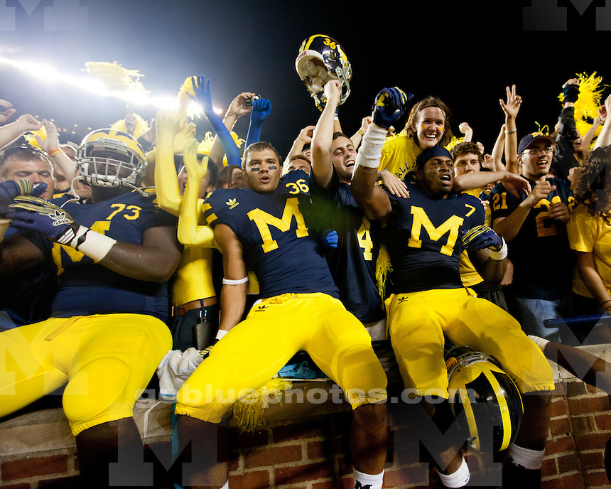 """The University of Michigan football team defeats the University of Notre Dame 35-31 """"Under the lights at the Big House"""" at Michigan Stadium in Ann Arbor, Mich., on September 10, 2011."""