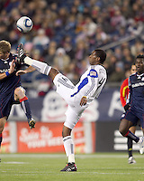 Kansas City Wizards midfielder Craig Rocastle (4) traps the ball as New England Revolution midfielder Jason Griffiths (16) defends. The New England Revolution defeated Kansas City Wizards, 1-0, at Gillette Stadium on October 16, 2010.