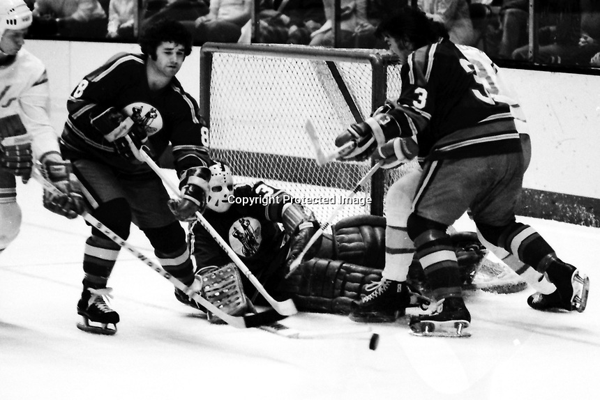 Kansas City Scouts Hugh Harvey, goalie Bill McKenzie and Dennis Patterson. (1975 action against the Seals)<br />
