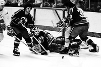 Kansas City Scouts Hugh Harvey, goalie Bill McKenzie and Dennis Patterson. (1975 action against the Seals)<br />photo by Ron Riesterer)