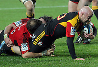Chiefs' Brendon Leonard is tackled by Crusaders' Adam Whitelock in a Super Rugby match, Waikato Stadium, Hamilton, New Zealand, Friday, July 06, 2012.  Credit:SNPA / David Rowland