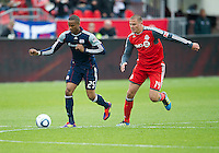 22 October 2011: New England Revolution defender Darrius Barnes #25 and Toronto FC forward Danny Koevermans #14 in action during a game between the New England Revolution and Toronto FC at BMO Field in Toronto..The game ended in a 2-2 draw.