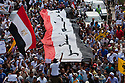 A mix of Salafi and revolutionary youth activists march through the Abbasiya district during May 4, 2012 demonstrations against the ruling Supreme Council of the Armed Forces (SCAF) near the Defense ministry building in Cairo, Egypt. The demonstrations lead to clashes in which three hundred people were injured , one killed, and another300 people arrested by the military. .