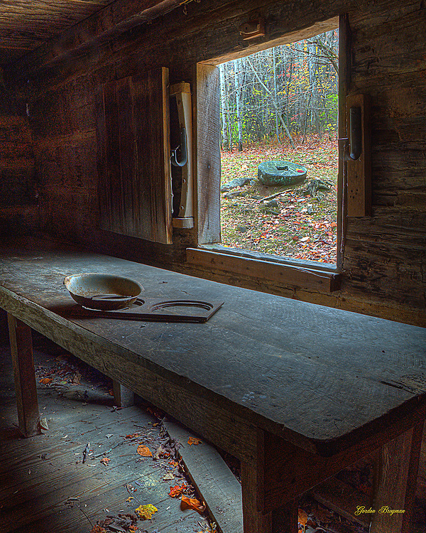 Artifacts rest on a table inside the Smoky Mountain Hiking Club Cabin along the Porters Creek Trail. Three exposure HDR image.