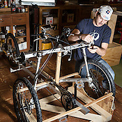 Mechanic Robert Howington works on an ELF velomobile ordered by comedian Jerry Seinfeld at Organic Transit, Durham, N.C., Friday, May 24, 2013