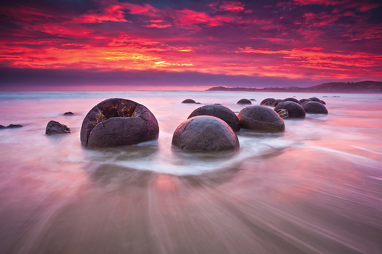 Moeraki Boulders and a fiery red dawn, Coastal Otago, South Island, New Zealand - stock photo, canvas, fine art print
